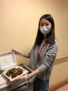 Broker Cherrie Lee with takeout food container.